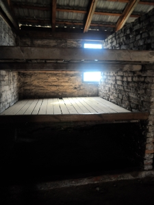 Eight people were expected to sleep on each of the three tiered 'bunks'